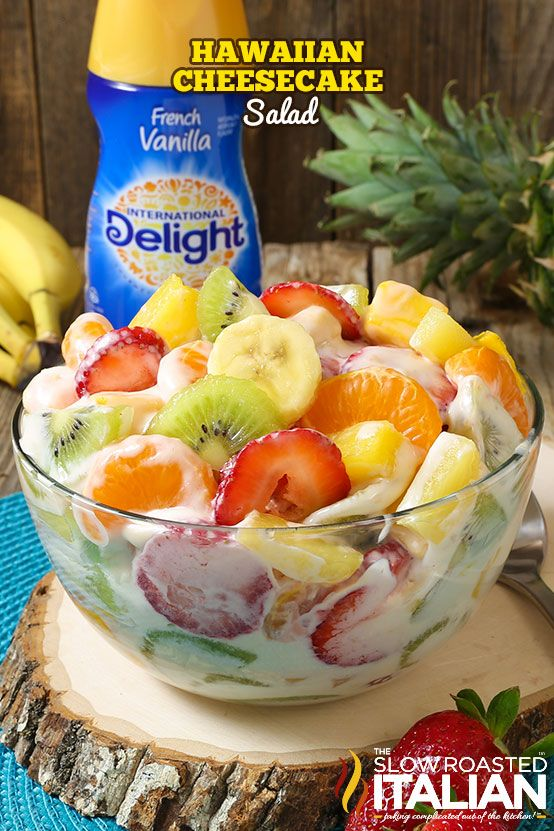 Hawaiian Cheesecake Salad comes together so simply with fresh tropical fruit and a rich and creamy cheesecake filling to create the most glorious fruit salad ever! Every bite is absolutely bursting with island flavor and you are going to go nuts over this recipe! @indelight #creamernation #internationaldelight #ad