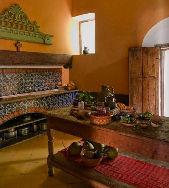 This is what a kitchen looks like in a typical Mexican home. It's very traditional with a lot of wooden textures. It's also very colorful and welcoming