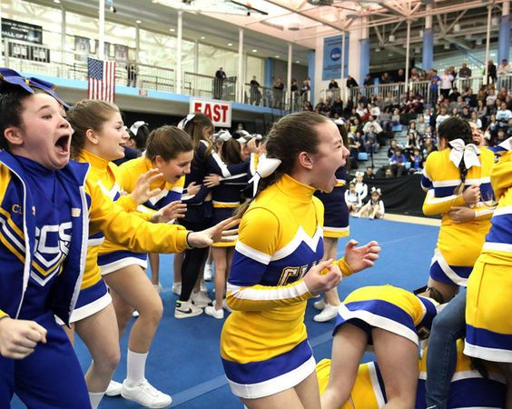St. Clare elementary small division celebrate their win at the 2015 CYO Cheerleading championship at the College of Staten Island in Willowbrook.  Saturday March 21, 2015. (Staten Island Advance/Anthony DePrimo)
