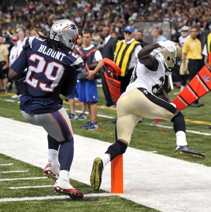 Best of NFL preseason - Week 2 - New England Patriots running back LeGarrette Blount (29) scores a touchdown as New Orleans Saints defensive back Brian Dixon (20) tries to defend in the second half of a preseason NFL football game in New Orleans, Saturday, Aug. 22, 2015.
