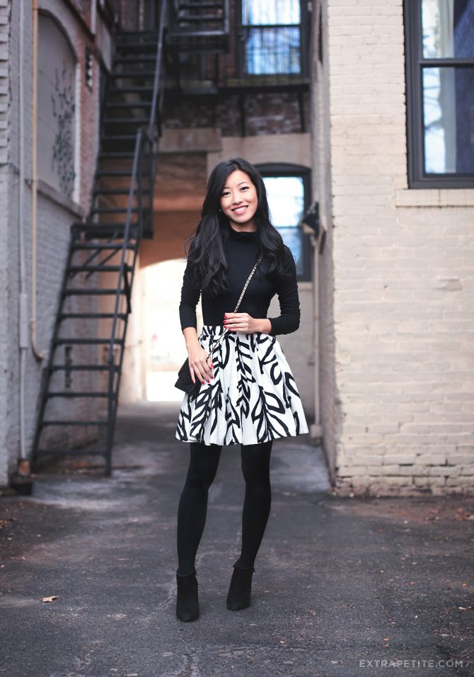 Printed flared skirt. Black tights. Black turtleneck. Black heels.