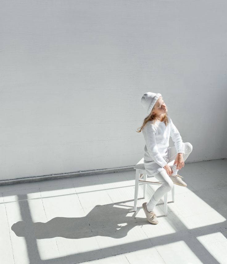 Simple white sports influenced fashion from Xenia Joost for summer 2015
