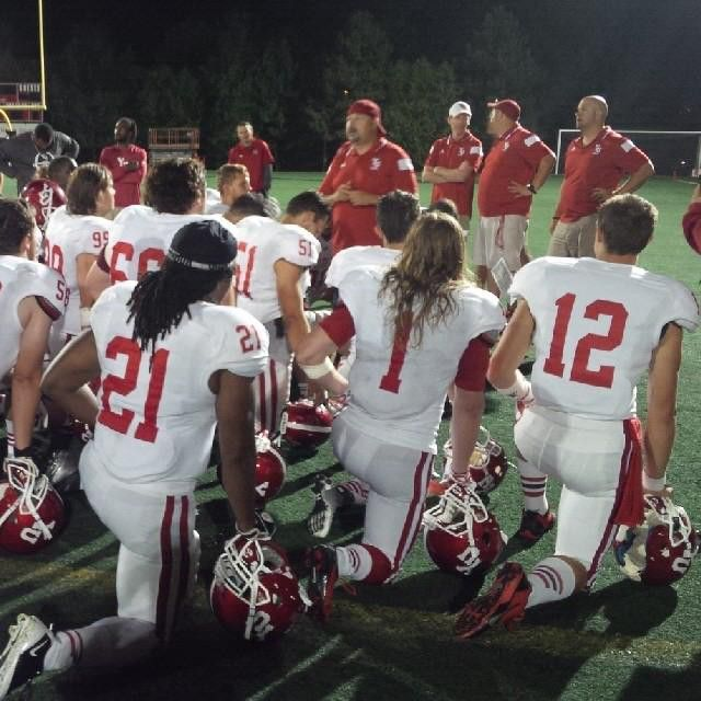 Head coach Warren Craney addresses the team after the pre-season game against Carleton. A beautiful night for a football game in the nation's capital! #lionpride