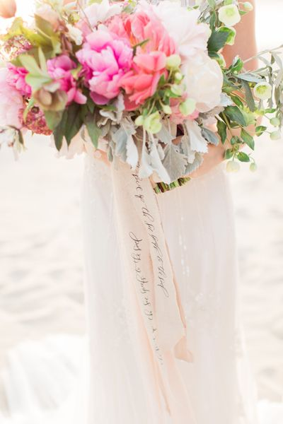 """For a truly personalized bouquet, Alyssa Thiel, owner of Parris Chic Boutique, wrapped the stems with a customized ribbon. """"We wrote 'The voice of the seas speaks to the soul' in calligraphy to reflect the seaside location and the way the ocean can make you feel alive,"""" she explains.Related: 50 Ideas for Beach Weddings"""