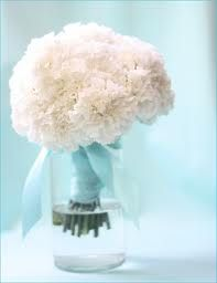 Bunching together carnations as a bridal shower centerpiece is not only chic but affordable. I would add a pop of purple carnations to go with my theme.