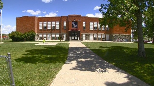 DIETRICH, Idaho - Dietrich's K-12 school was locked down Wednesday afternoon, and students were eventually bussed to another location, after the school received a number of threatening calls, and a person entered the school despite a teacher's pleas not to.