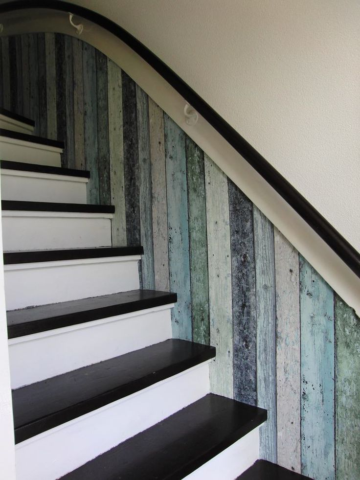 recycled wood panels add texture and interest to this stairwell ...