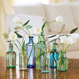 DIY made easy! This is a great example of showcasing a stem or two per arrangement. Shop tulips, seeded eucalyptus, and other popular wedding flowers at GrowersBox.com.White Flower, Ideas, Vintage Bottles, Glasses, Vintage Wardrobe, Flower Vases, Wedding Flower, Centerpieces, Sea Glass
