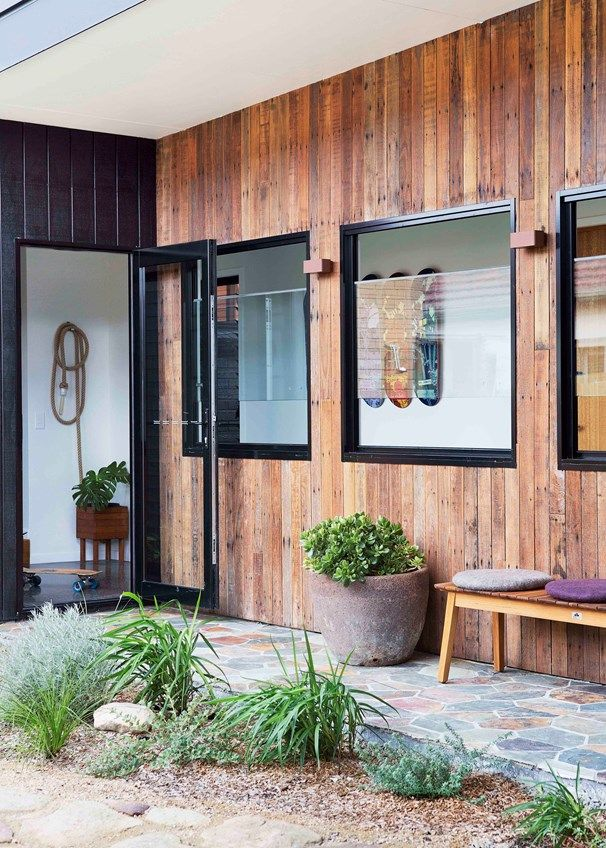 Recycled timber flooring from an old shed on the original property lines the external wall |Home Beautiful magazine Australia