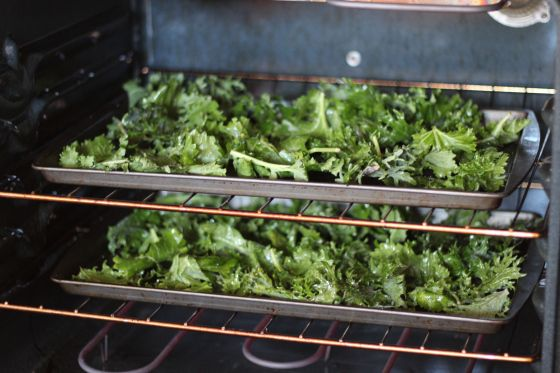 4 cups kale olive oil spray sea salt Directions: Preheat oven to 275 degrees. Take kale from bag and place in a single layer on a baking sheet. Spray lightly with olive oil and add sea salt to taste. Bake for 20 minutes or until crisp but not charred