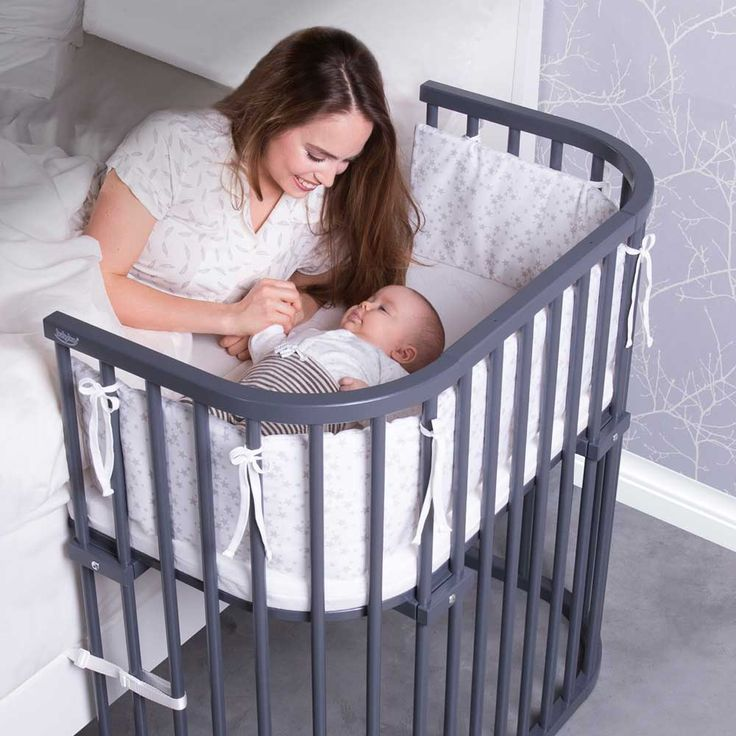 The deep walnut babybay® Bedside Sleeper is a co-sleeper baby crib that leaves parents well rested