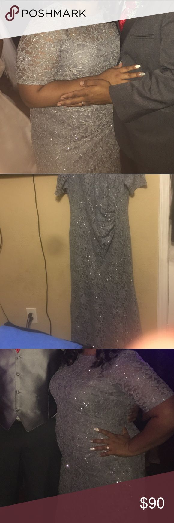 Elegant Grey dress, sparkly/glittery, 3/4 sleeve Grey dress, sparkly/glittery, long, 3/4 sleeve, stretchy material lace. Very elegant I am usually size 16 but it fit nice perfect and comfy. Worn once for a wedding. Dresses