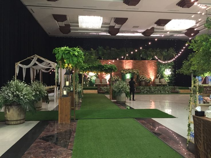 wedding reception surabaya indonesia decoration rustic greenery indoor pelaminan