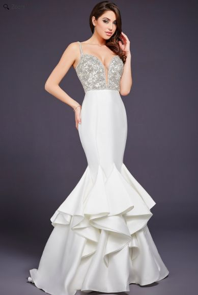Jovani 32355 Stunning mermaid dress features a plunging sweetheart neckline and crystal embellished bodice and spaghetti straps