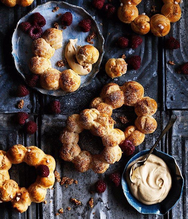 Choux wreaths with burnt-honey cream, raspberries and sesame praline