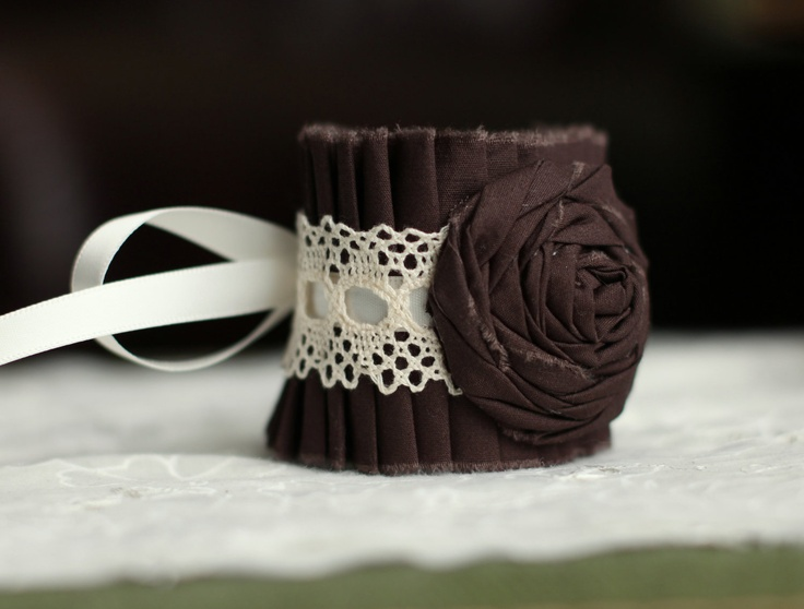 I can't decide between this one or the plain lace! Lace Bracelet Ruffle Cuff Cream & Brown- Bridal Bracelet, Vintage Lace Bracelet, Rocker Chic Cuff, Bridesmaid Bracelet, Wrist Corsage. $25.00, via Etsy.