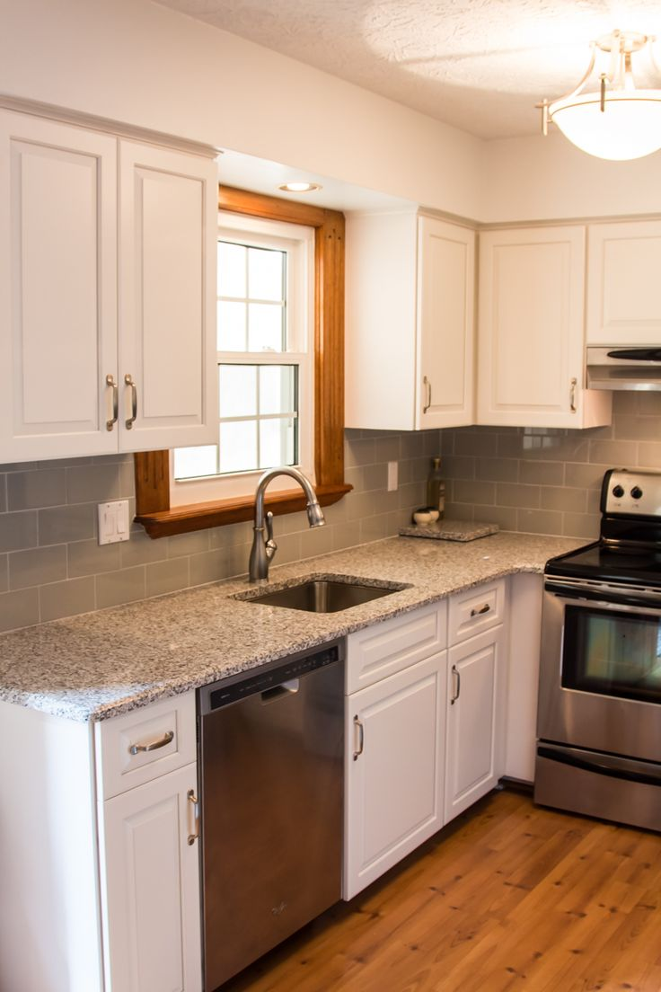 White Cozy Kitchen With Grey Subway Tile And Stainless Steel Appliances In  Germantown, MD.