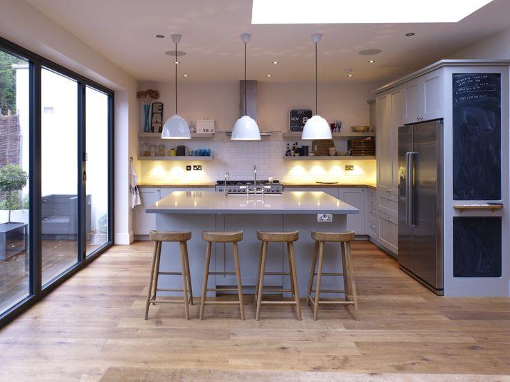 Lay on framed kitchen with Tulipwood doors, Oak Veneer cabinets and Oiled Oak worktops.