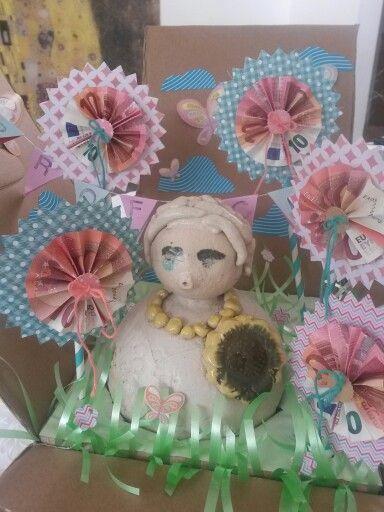 Geldbloemen vouwen ; ~) voor een bloementuitje