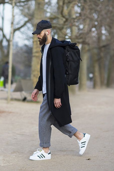 I love the mixture of athletic gear mixed with tweed pants and long coat. It's a real smart outfit for traveling specially for fall.