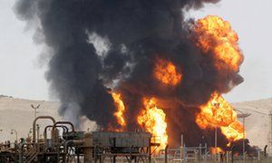 Bai Hassan, Iraq oil facility on fire, after being attacked by ISIS