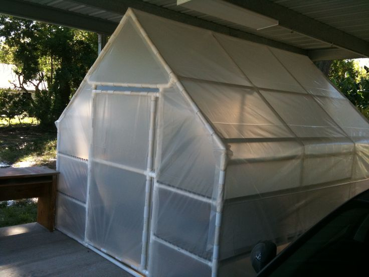 Build a PVC Greenhouse - not airtight, but would certainly help with get the seedlings out of the basement, and keep the cold-sensitive plants from crowding inside during winter months.