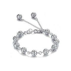 Bracelet boast delicate silver plated hollow balls. Dress up a casual outfit or wear it for an evening out. Ideal as a gift for someone special
