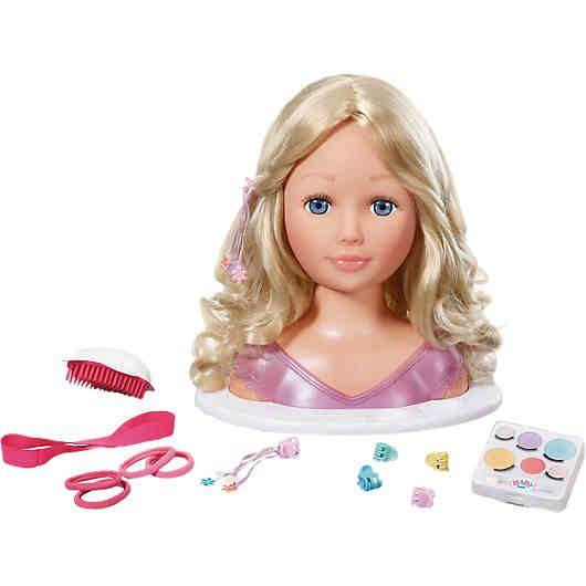 Mit diesem Schmink- und Frisierkopf können Kinder spielerisch kreativ werden. Frisur und Make-Up des Styling-Kopfes lassen sich immer wieder verändern, ganz nach Geschmack und Laune der jungen Stylistin.<br /> <br /> Der Schminkkopf zeichnet sich durch qualitativ hochwertiges und waschbares Haar und viel Zubehör aus. <br /> <br /> <br /> Auf einen Blick:<br /> - Höhe: 27 cm<br /> - qualitativ hochwertige Haare<br ...