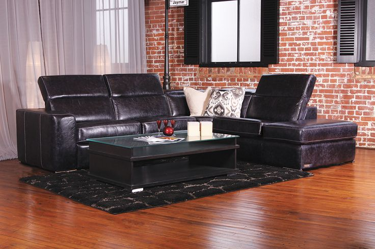 James black leather sectional by Jaymar. Retractable head-rest included Power recline mechanism. Made in Canada.