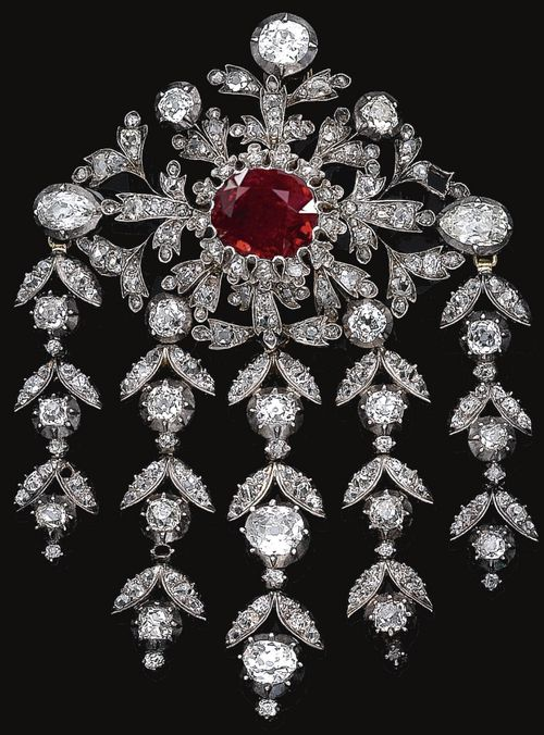 Ruby and diamond pendant, mid 19th century. Centrally set with a cushion-shaped…