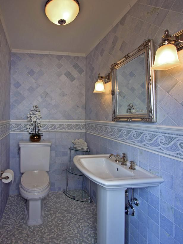 Beach Waves - Beach-Inspired Decorating Ideas for Bathrooms on HGTV. I like the blue and white.