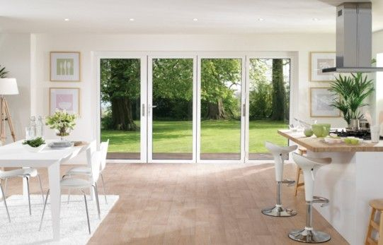 White Aluminium Folding Doors.   Love the huge amount of space between kitchen and dining.