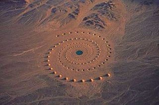 """Created by Greek artist Danae Stratou and the DAST art team in the mid-1990s, this earthwork art is called """"Desert Breath."""" It covers 100,000 square meters in the Egyptian desert near the Red Sea, and took several years to create. At its center was a fairly deep pool of water, and the whole project was designed to slowly erode over time."""