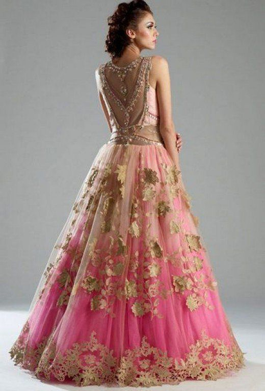 Peach-and-pink feminine, flowing and voluminous gown-type lehenga