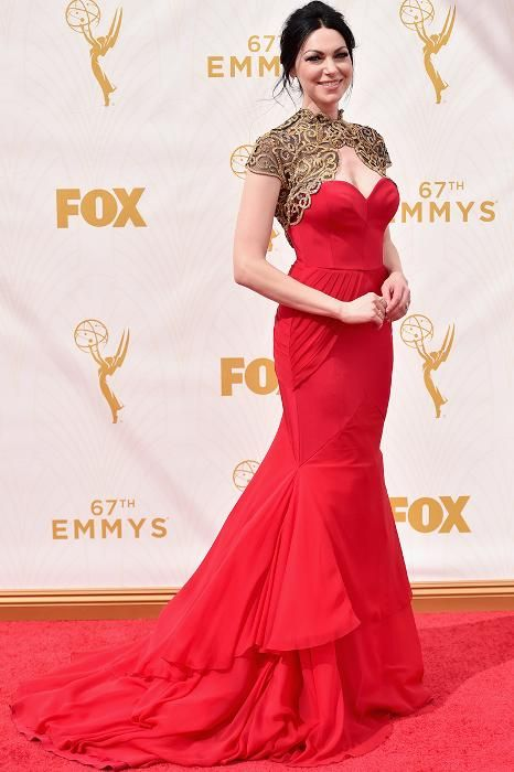 The Best-Dressed Celebrities from the 2015 Emmy Awards Red Carpet: Orange is the New Black actress Laura Prepon wore a dramatic silk-and-chiffon red gown with a mermaid train and a gold bolero by Christian Siriano.