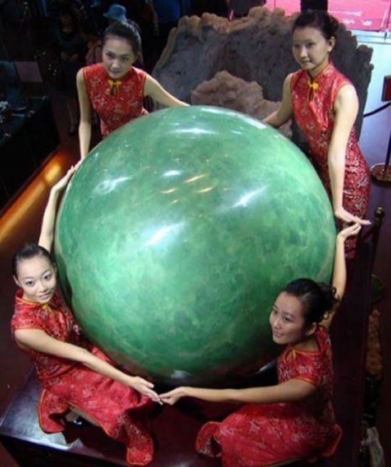 Mongolia. The stone, (5 ft high, weighing six tons) formed mostly of fluorite mineral, glows green in the dark and in China is prized more highly than diamonds. The finders took three years to grind the raw gem down to its pearl shape. It has gone on show in Hainan, southern China, to attract buyers and have measurements taken for a world record bid. It is amazing and glows a blue green in the dark,'