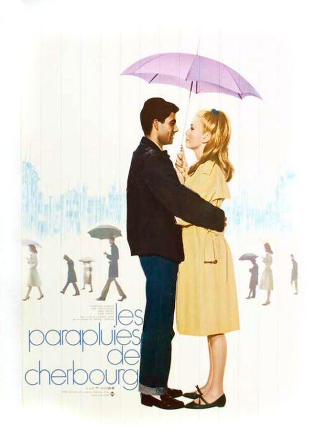 """Les parapluies de Cherbourg - Jacques Demy 1964 - DVD08120 -- """"Madame Emery & sa fille Geneviève tiennent une boutique de parapluies. La jeune femme est amoureuse de Guy, un garagiste. Mais celui-ci part pour la guerre d'Algérie. Enceinte & poussée par sa mère, Geneviève épouse Roland, un riche bijoutier."""""""