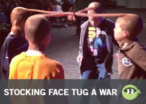 Stocking Face Tug A War: Last person with stocking on his head, wins
