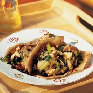 Moo Shu Pork is a typical stir-fried dish in northern China. It's made with pork, green onions, mushrooms, and scrambled eggs, all rolled into small, thin pancakes instead of being served over rice.