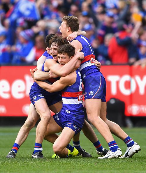 Jackson Macrae Josh Dunkley Liam Picken and Toby McLean of the Bulldogs celebrates winning the 2016 AFL Grand Final match between the Sydney Swans...