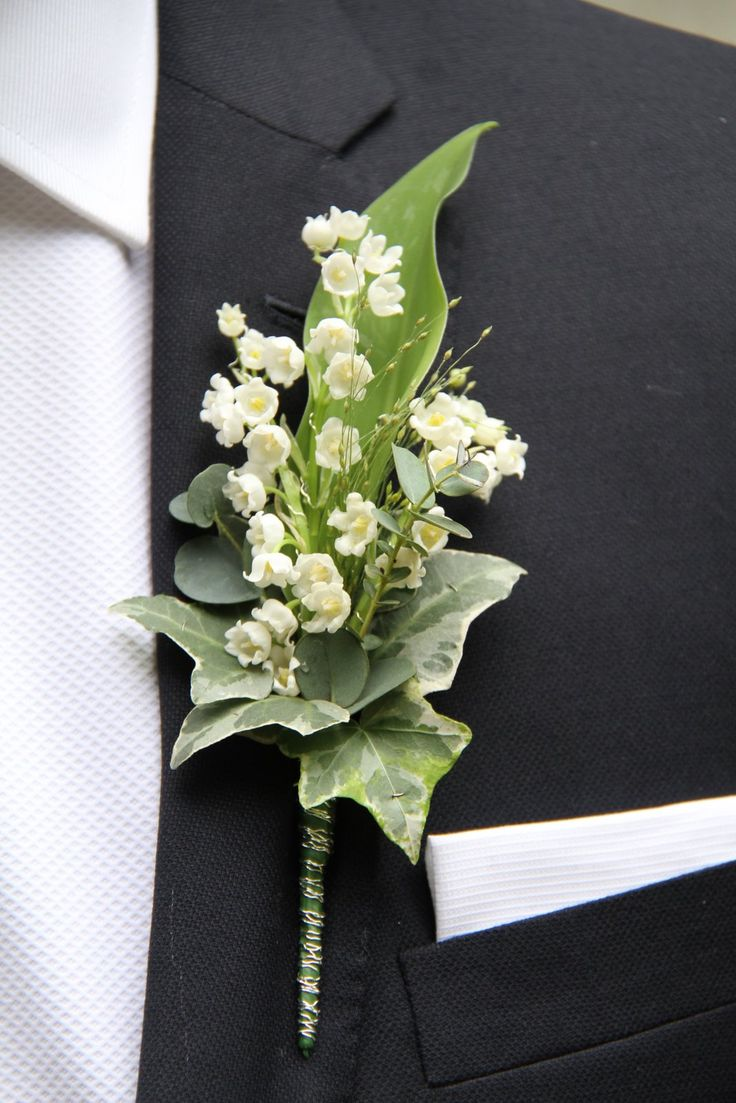 The perfect Groom's Buttonhole very simple yet utterly elegant, sweet scented Lily of the Valley, a little sprig of Eucalyptus
