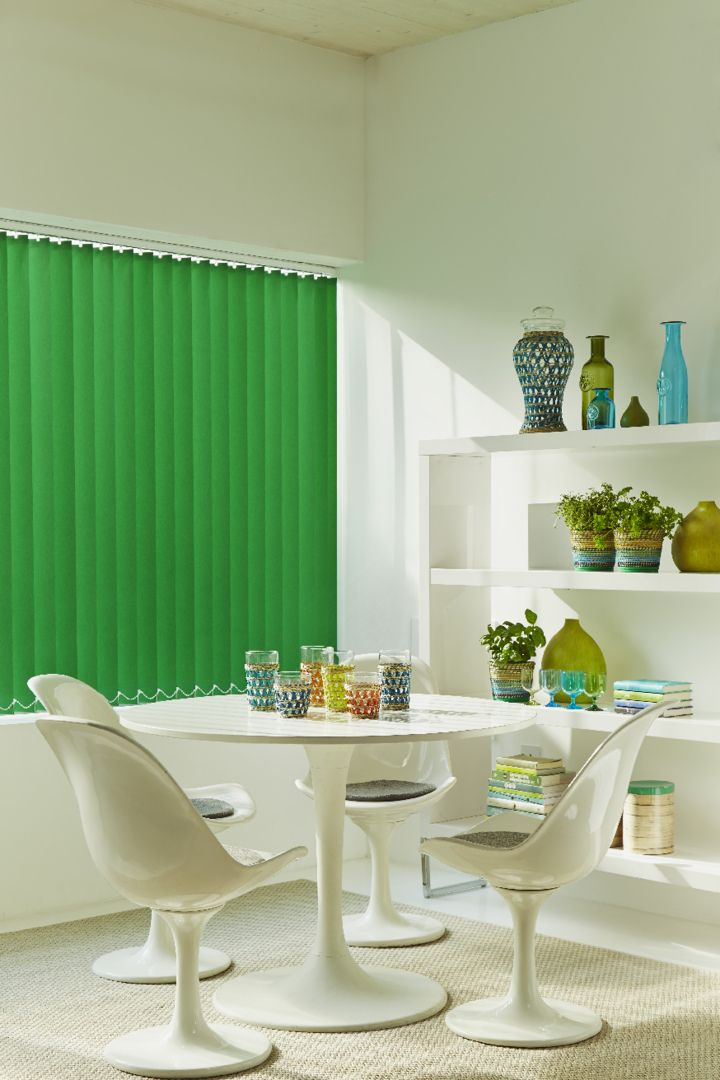 Glass and bright colours can add pops of colour in to a white room. Made to measure Acacia Emerald vertical blind is perfect. Great for living rooms and dining rooms.
