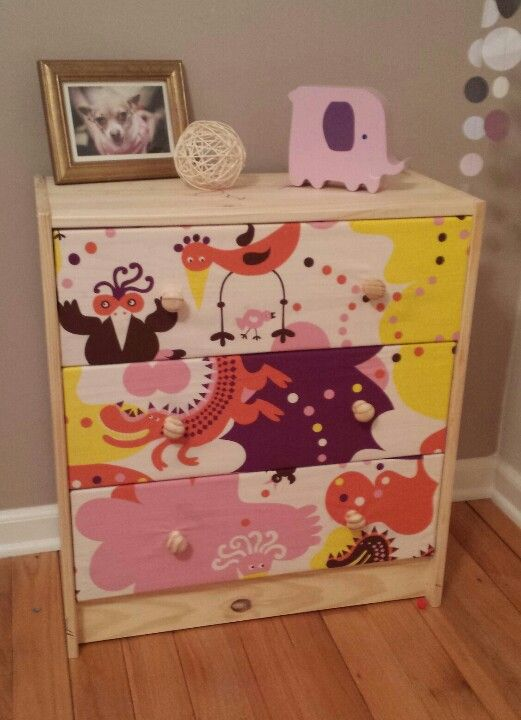 Fabric covered drawers on a an ikea kids dresser.