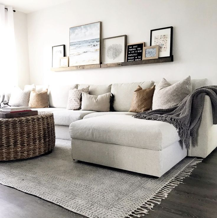 white gray and wood - especially the floating shelf above the couch!