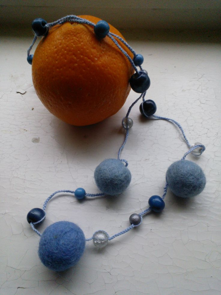 Felted balls with glass  and wooden beads. Orange likes to be there too...