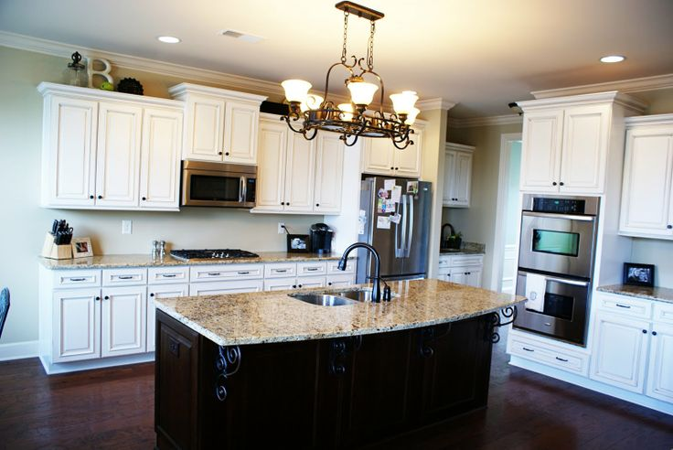 White kitchen cabinets with black hardware and a dark wood for Black hardware on white kitchen cabinets