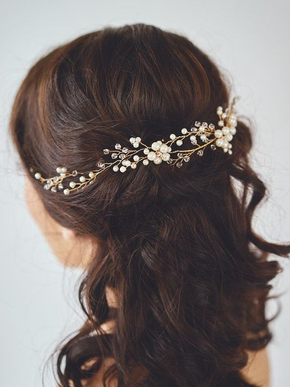 A constellation of glass beads and ivory pearls strung along a golden wire. This hair wreath is secured with hairpins or you have the choice of a