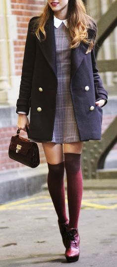 preppy look: gray plaid dress with white collar, navy blue and gold buttons pea coat, maroon thigh-high socks and booties