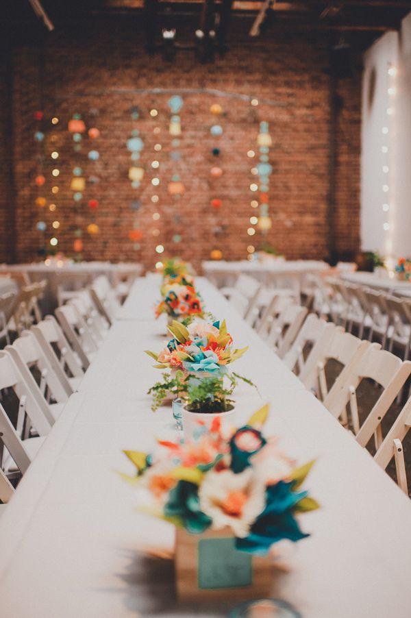paper flower centerpieces, photo by Carina Skrobecki http://ruffledblog.com/seattle-art-gallery-wedding #paperflowers #weddingreception
