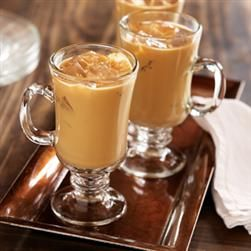 Iced Vanilla Latte   1 cup strong brewed Folgers® French Vanilla Flavored Coffee, * cooled to room temperature  1 (12 fl. oz.) can PET® Evaporated Milk, chilled  1/3 cup sugar  Ice cubes